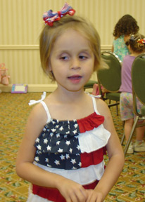 Laura�s daughter, Lindsay Adair (TX) in her Fourth of July regalia at the 2006 convention.