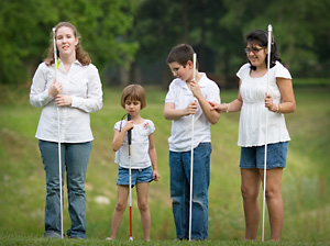 4 children posing with thier canes